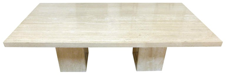 A fantastic, massive, Italian travertine dining table. An expansive, chunky table-top held by two open pedestal bases of graduating, concentric rectangles. Monumental scale and proportions. Echoing the spirit of the Delfi table by Scarpa and Breuer,