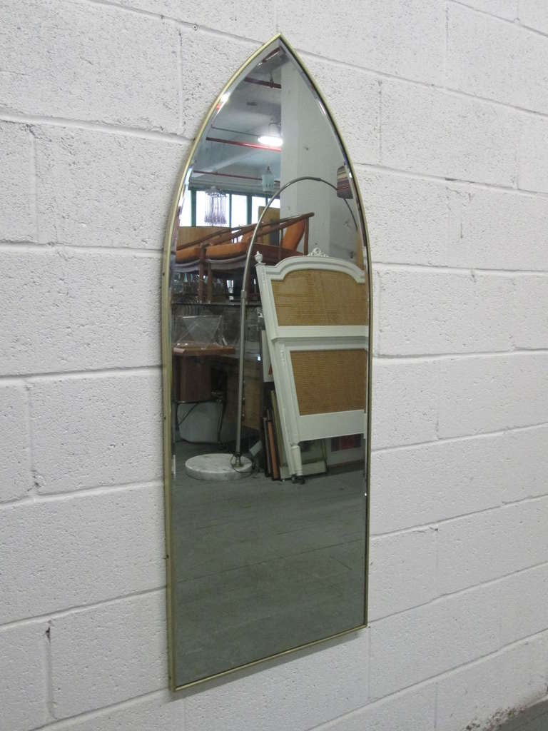 Italian modernist arched mirror with brass frame.