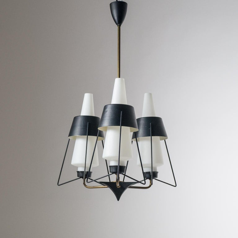 Very unique modernist Italian chandelier from the 1950s. Three brass arms each with a satin glass 'triplex opal' diffuser encased in Sputnik like structure with black lacquered shades. Fine original condition with patina on the brass and some light