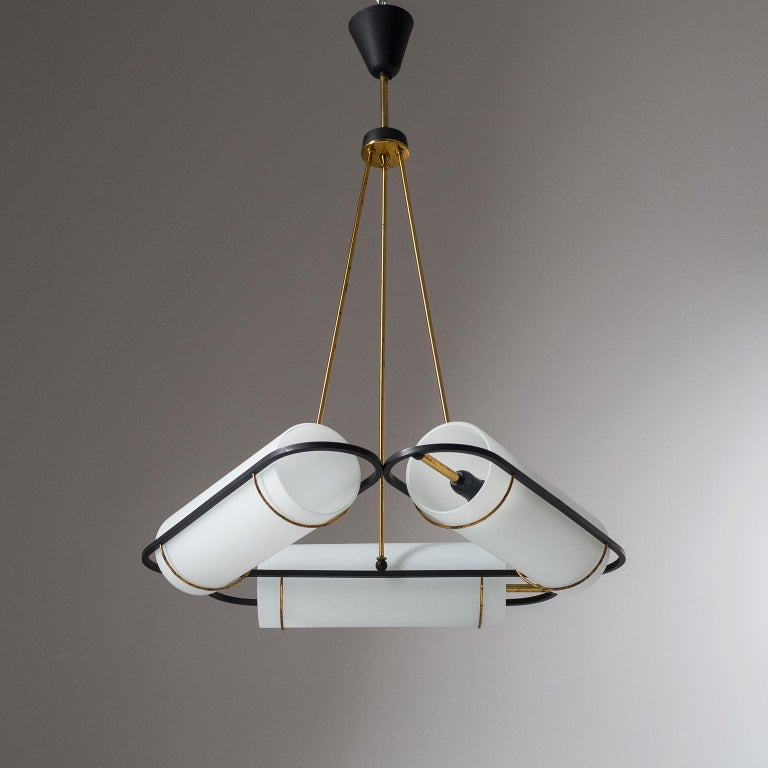 Very rare Italian modernist chandelier attributed to Stilnovo from the 1950s. Three arms arranged in triangular form, each with a large acid-satinated glass diffuser and an original E14 socket with new wiring. Very good original condition with