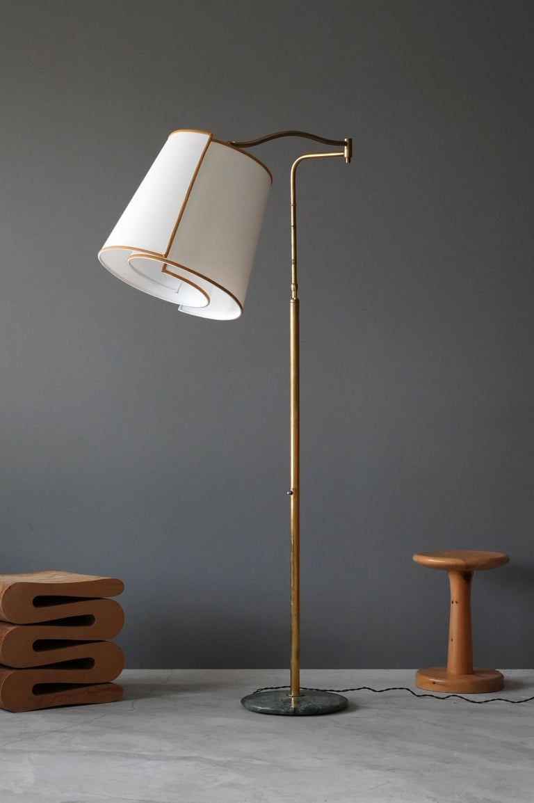 A highly modernist floor lamp. Designed by an unknown Italian designer. Produced in Italy, 1970s. Features brass, marble base, and a custom screen.  Other Italian lighting designers of the period include Angelo Lelii, Max Ingrand, Gino Sarfatti,