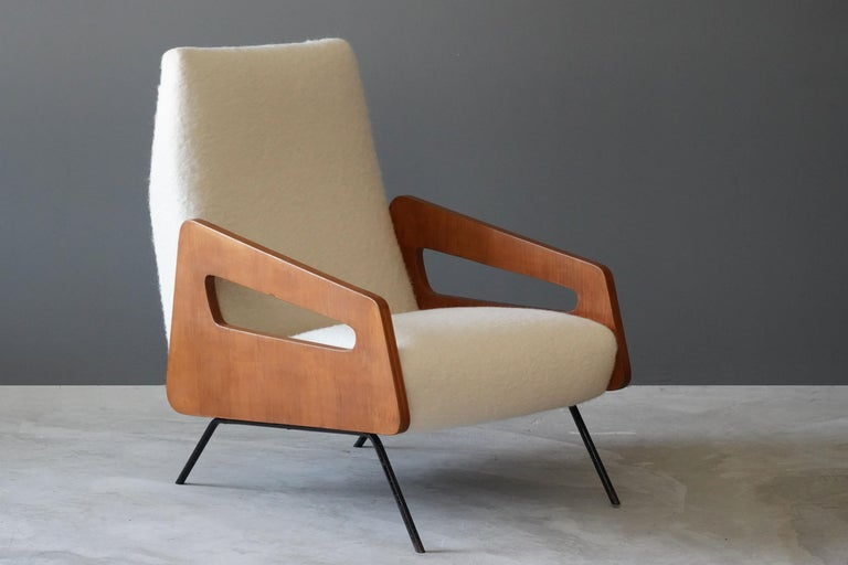 A pair of highly modernist lounge chairs. Designed and produced in Italy, 1950s. Features an interesting mix of materials, brand-new white high-end bouclé, wood, and lacquered steel.  Other designers of the period include Gio Ponti, Franco Albini,