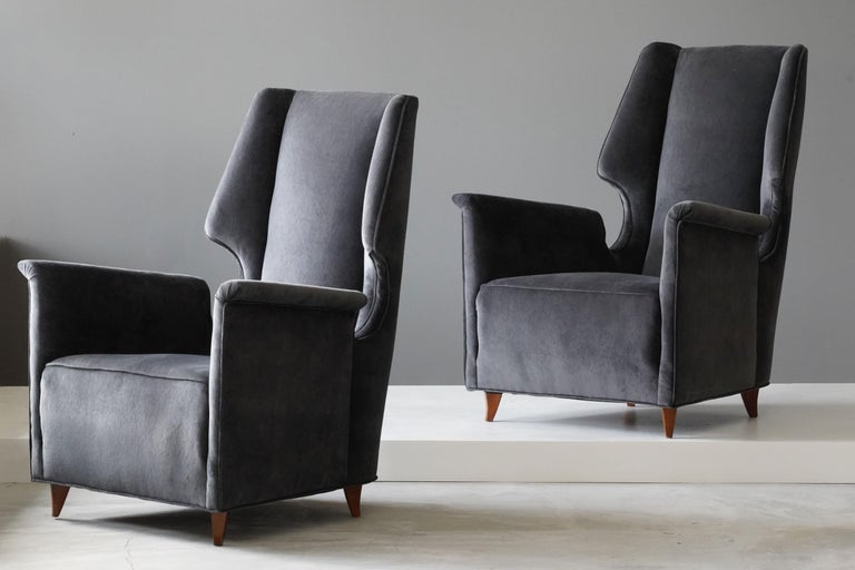 A pair of lounge chairs designed by an unknown Italian modernist designer, 1950s, Italy. Upholstered in new high-end velvet.  Other Italian designers of the period include Gio Ponti, Franco Albini, Paolo Buffa, Carlo Mollino, and Ico Parisi.