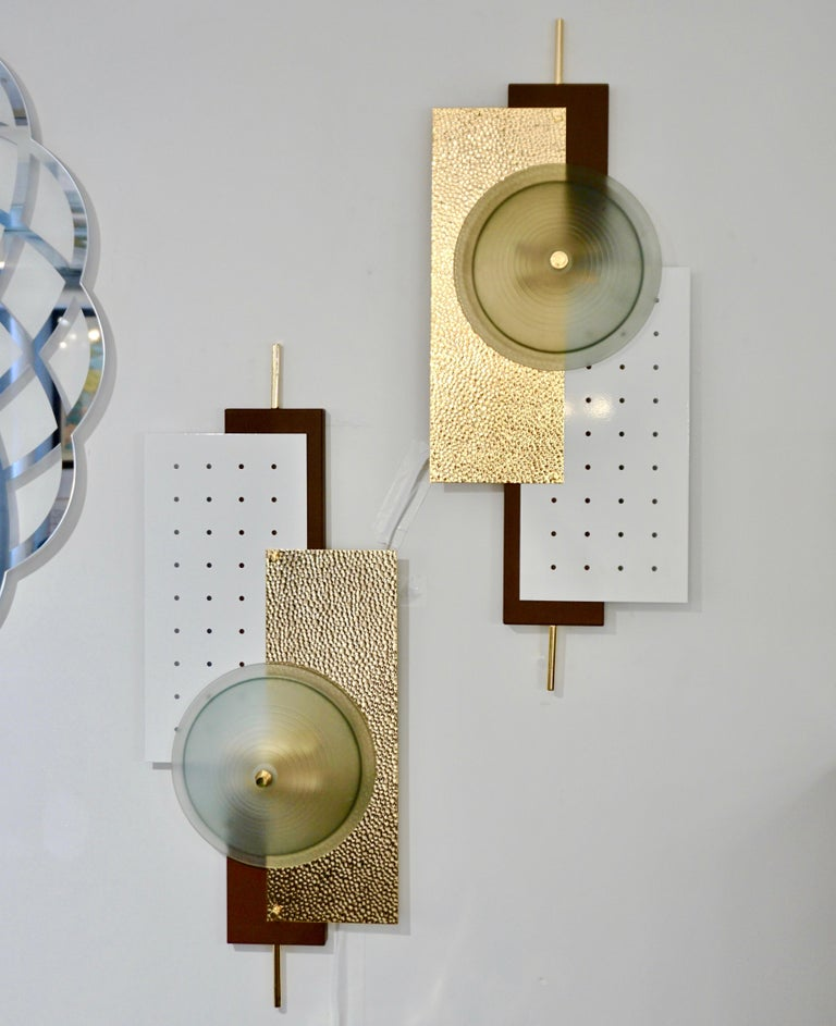 Contemporary pair of Italian wall lights inspired by the Memphis-style geometric shapes and differing colors. A very modern sleek design, with an accent on textures, consisting of offset rectangular metal shapes, one in perforated metal cold painted