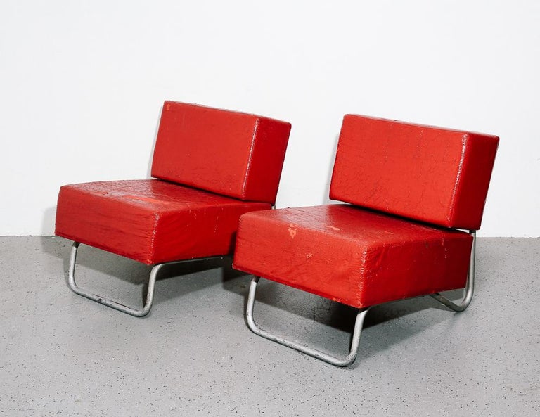 Modernist lounge chairs with silver painted tubular frames and red foam cushions. Signed Aerre Arredatori Riuniti / Messina. 2 available.  Measure: 17