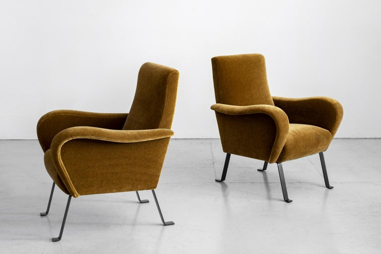 Stunning pair of Italian chairs with curved arms and back. Flat bar black iron legs with feet. Eye-catching from any angle. Newly upholstered in deep olive mohair fabric. Matching pair in leather also available.