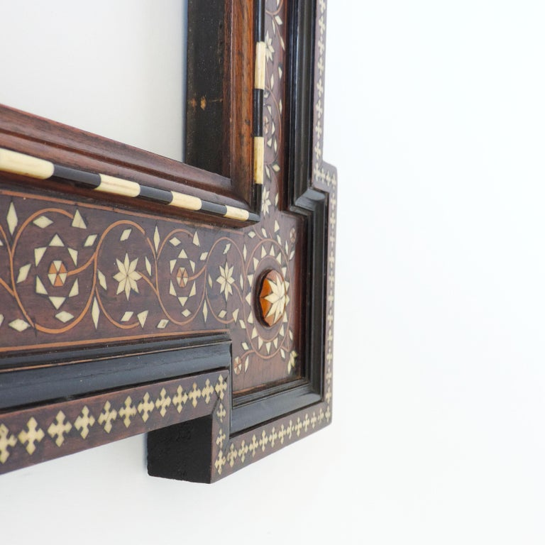 A beautiful Italian Moorish bone inlay frame with saint (Inscribed Roma) for a painting or a mirror. Very much in the Renzo Mongiardino Taste. Inner frame size 64.5 x 51 cm.