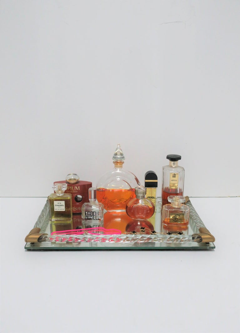 A very beautiful rectangular Italian Murano art glass, mirror, and brass vanity tray, circa mid-20th century, Italy. This is a beautiful tray with twisted Murano art glass, brass corner accents, on a mirrored base tray. The size of this vanity tray