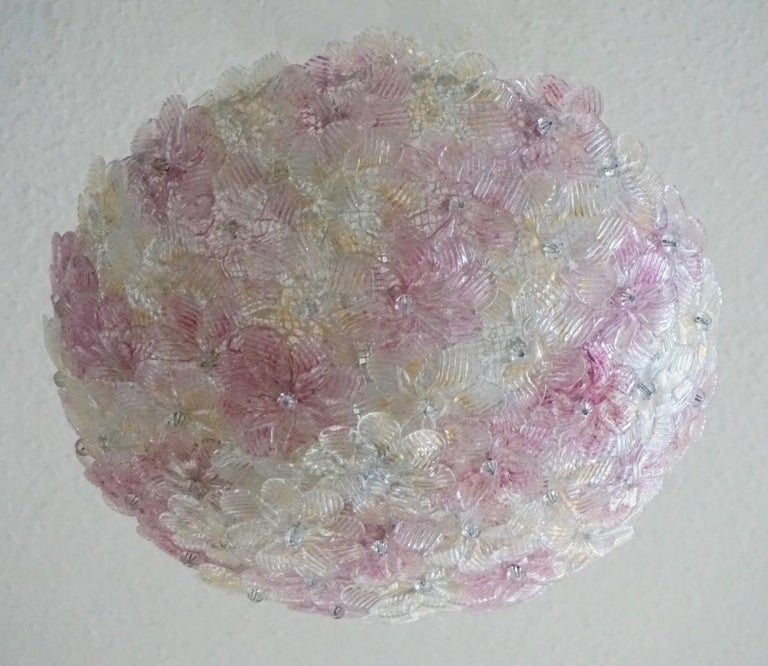 A lovely Barovier & Toso Venetian ceiling basket with overlapping hand blown Murano glass flowers pink and ice with gold inclusion, mounted on a metal webbed white painted frame. This flush mount can also be used as a wall lamp. Recently rewired