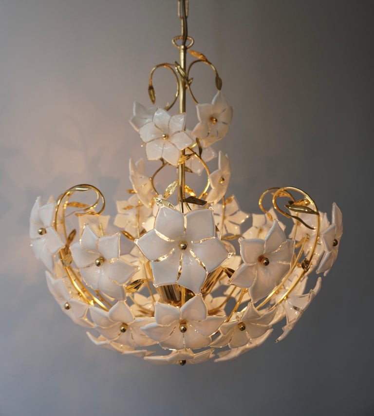 1960s vintage Italian Murano flower bouquet after Venini art-glass hand-blow white and clear glass flowers and gold-plated brass.  Measures: Diameter 50 cm. Height fixture 55 cm. Total height including the chain and canopy 112 cm. Weight 6