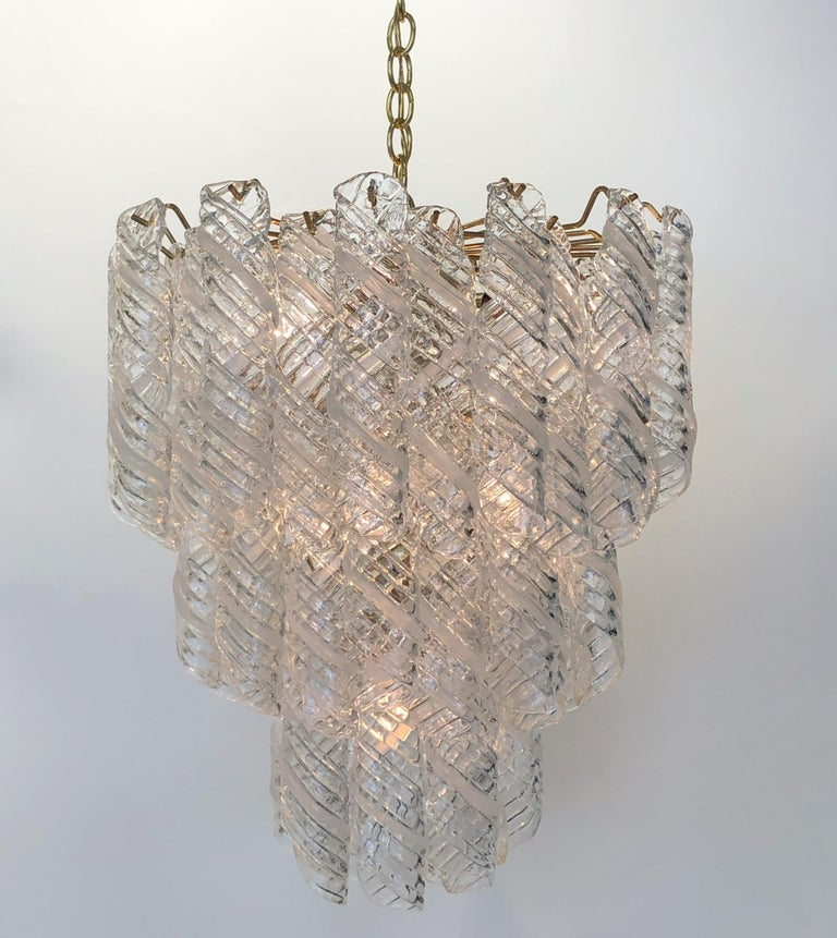 A glamorous 1970s Italian Murano glass and polish brass chandelier designed by Carlo Nason for Mazzega. Each piece of glass is handblown. The chandelier has been newly rewired. The chandelier takes six regular Edison light bulbs. We can extend the