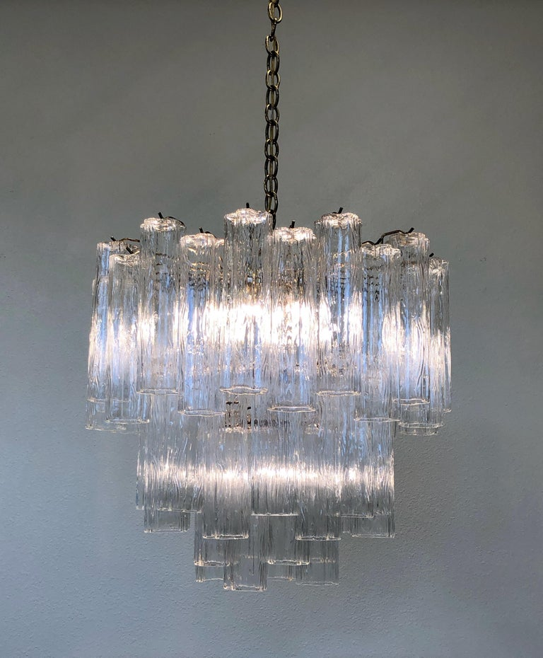 """For your consideration a glamorous 1970s Italian Murano glass and brass """"Tronchi"""" chandelier by Venini. Newly rewired. The chandelier takes eight candelabra light bulbs and one regular Edison light bulb. Dimensions without chain- 24""""diameter"""