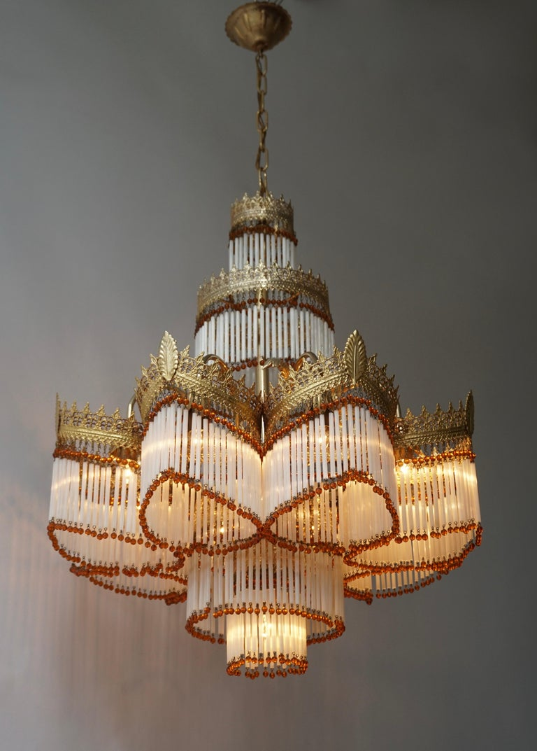 Beautiful large Italian Art Deco Murano glass and brass gilt chandelier. Measures: Diameter 62 cm. Height fixture 75 cm. Total height including the chain and canopy 110 cm.