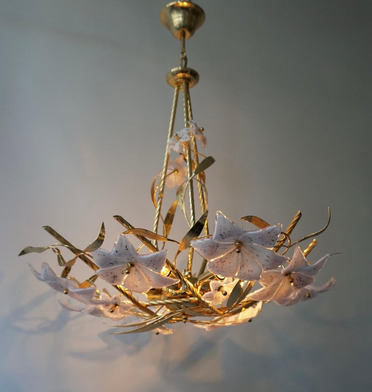 Wonderful Italian Murano glass flowers and brass chandelier, composed of multiple white and pink opalescent Murano glass flowers.