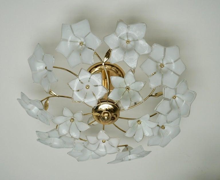 Italian Murano glass and brass flower flush mount or sconce. Measures: Diameter 48 cm. Height 20 cm. Three E14 bulbs.