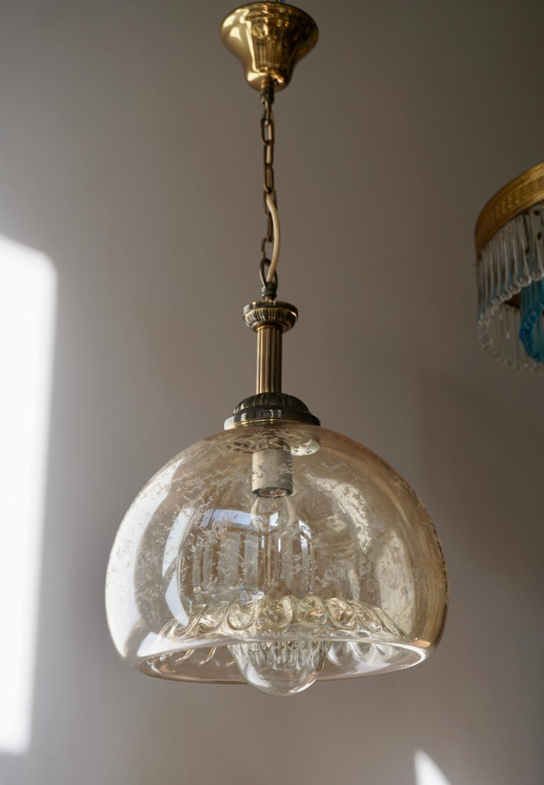 Italian Murano glass ceiling light.  Measures: Diameter 30cm. Height fixture 44 cm. Total height including the chain and canopy 74 cm.