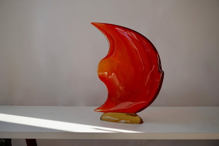 Italian fish sculpture hand blown and crafted in multiple colors of Murano glass, not signed. Made in Italy in the 1950s-1970s. Measures: Height 31 cm. Width 25 cm. Depth 6 cm. Weight 2 kg.