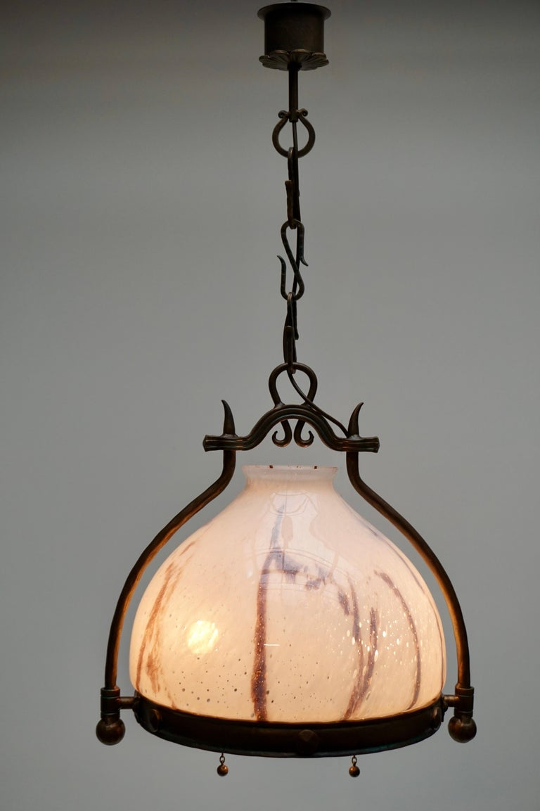 Italian Murano glass and metal pendant light. Height fixture 58 cm. Total height including the chain and canopy 82 cm. Three E14 bulbs. Weight 10 kg.