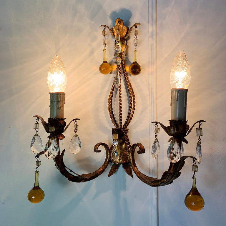 Italian Murano glass drop gilt wall light Italy circa 1960s Gilt leaves decorate the gilt rope detail central column Large hanging hand blown golden Murano glass droplets are hung from the lampholders and top crown of the light Smaller faceted