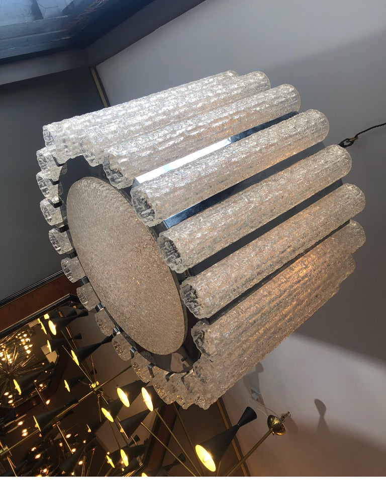 A large drum style chandelier in chrome with Murano glass tubular shades and matching glass dish shade beneath. Italian attributed to Venini. Hung from chain which can be extended to any length. Sizes given in product details are of actual light