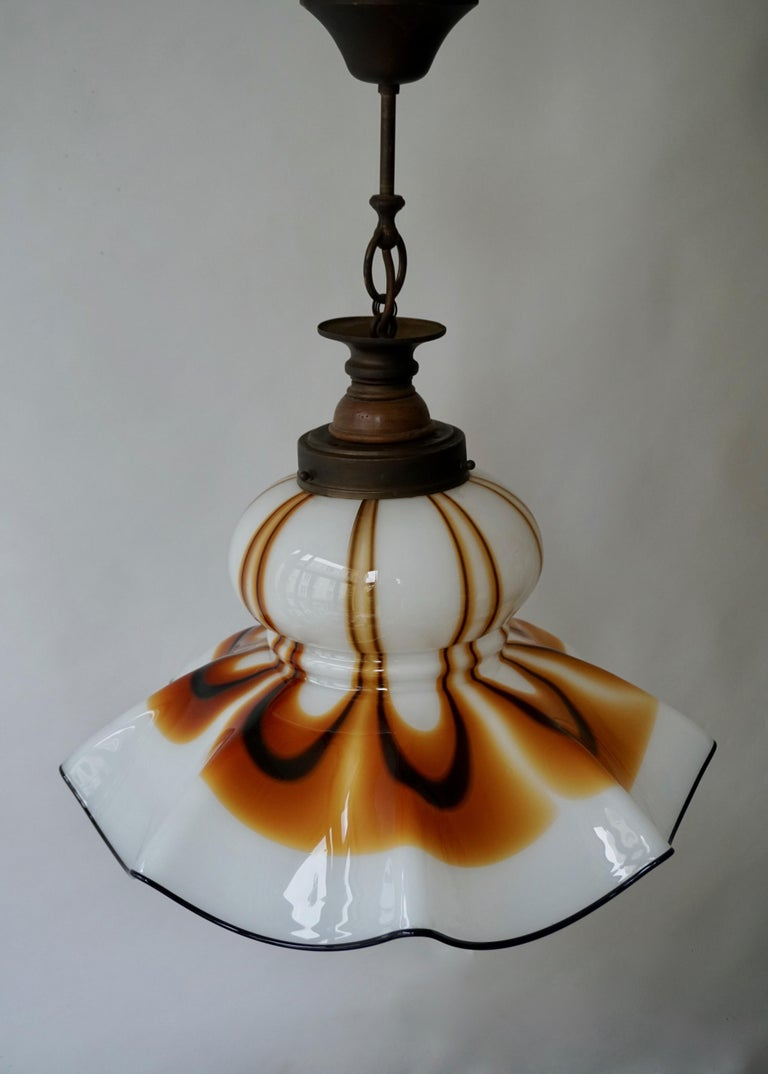 A sculptural Murano glass ceiling light fixture. This pendant lamp has a highly decorative design.