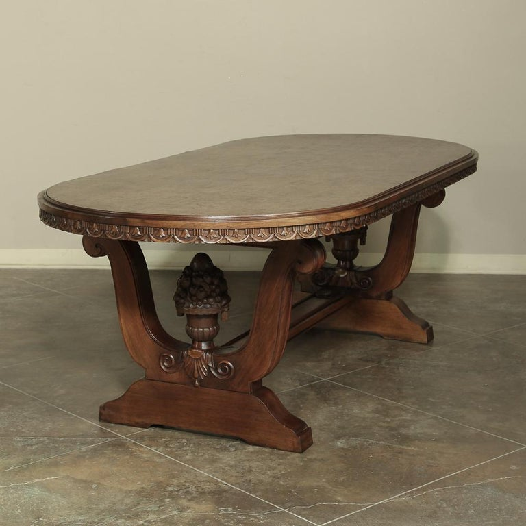 Amazing Italian neoclassic oval walnut dining table, recalling the glory days of ancient Greek and Roman civilizations, this stunning dining table has captured the Classic architecture from that storied period of history in sumptuous walnut with