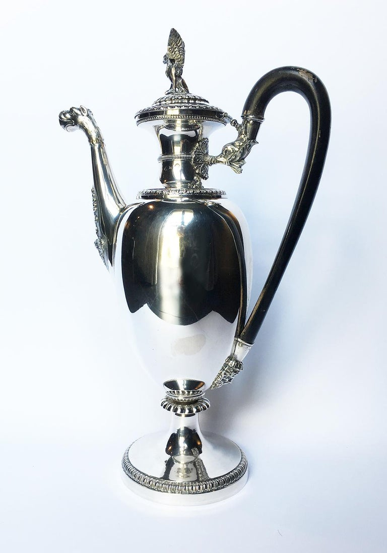 Embossed and engraved sterling silver coffee pot Tommaso Panizza (1805-1868) Milan, circa half of the 19th century It measures 13.97 in (cm 35.5) in height x 8.66 in (22 cm) x 4.72 in (12 cm) It weighs 1.94 lbs (884 g) State of conservation: