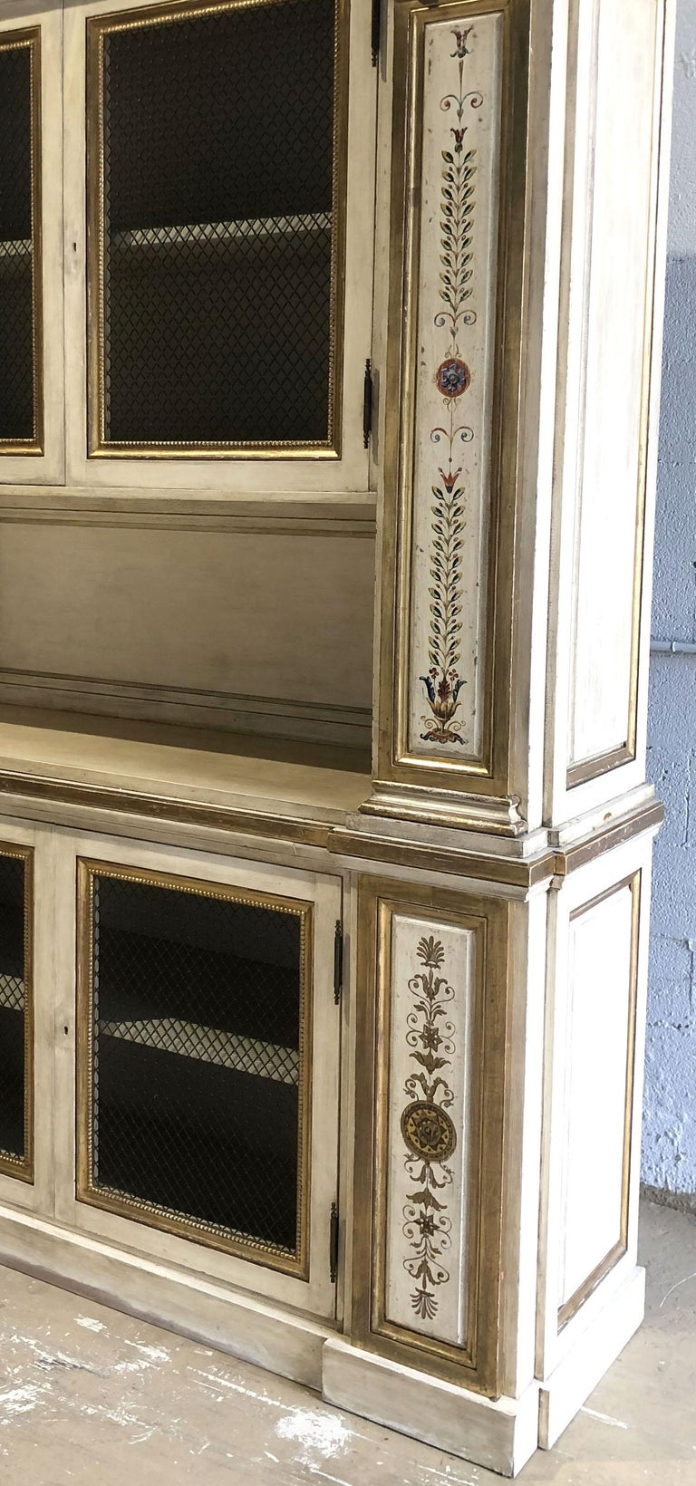 19th Century Italian Neoclassic Style Cream Painted and Parcel-Gilt Breakfront/ Bookcase For Sale