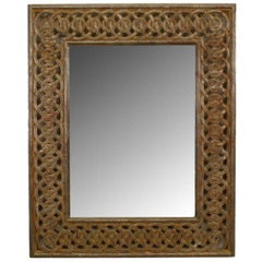 Italian Neoclassic Style Wall Mirror with a Patterned Gilt Frame