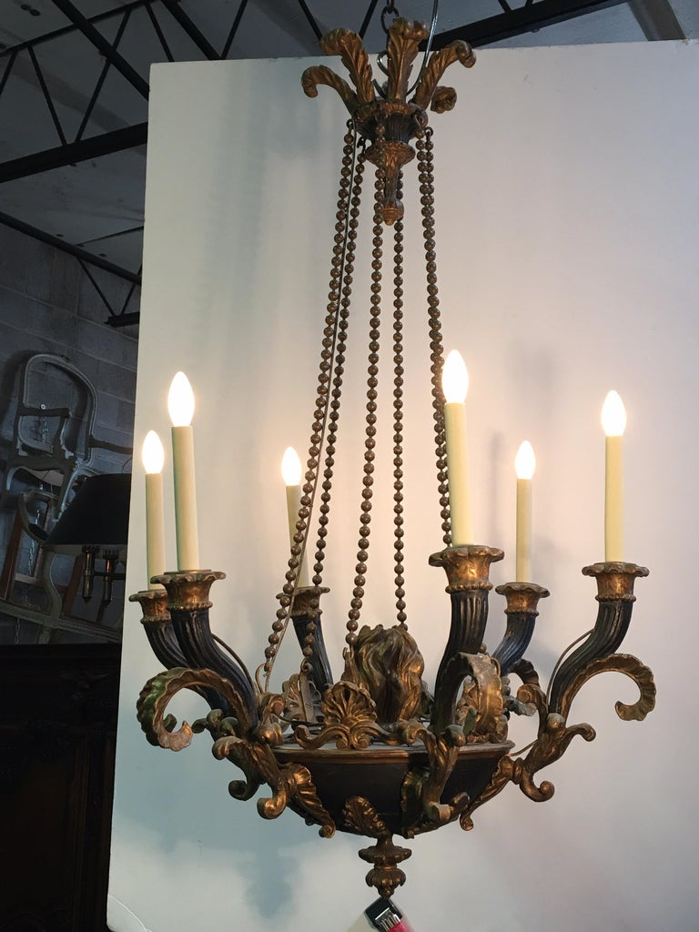 Italian Neoclassical carved wood chandelier with a painted and parcel gilt finish and bronze roping.