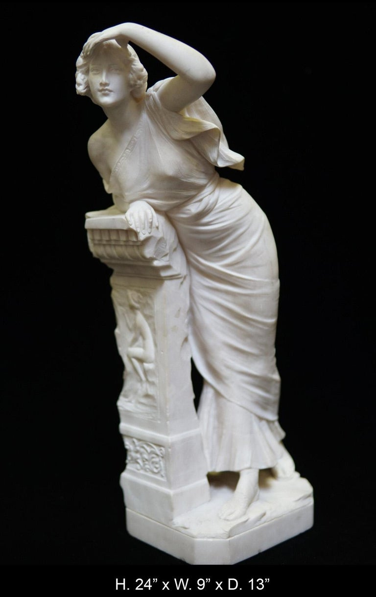 Fine Italian neoclassical style hand-carved white Alabaster sculpture depicting a standing maiden dressed in neoclassical garments/ leaned on an architectural pedestal, portraying a seated nude relief , all raised on a conforming rectangular plinth.