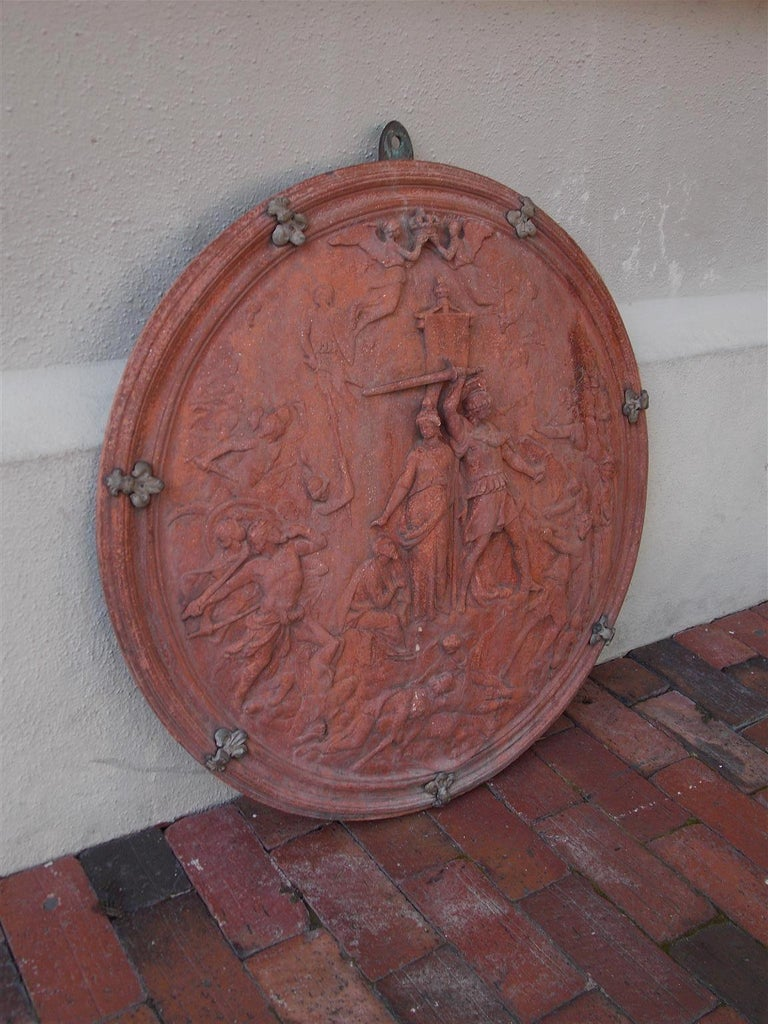 Italian neoclassical wall mounted terracotta shield with decorative figural neoclassical scenes, bronze mounted Fleur-de-Lis and re-verso inset bronze wall mount. Mid-19th century.
