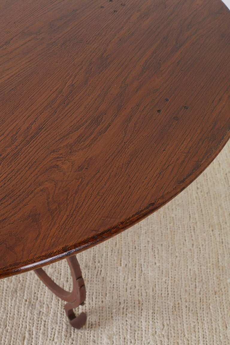 Italian Oak and Scrolled Iron Round Dining Table For Sale 4
