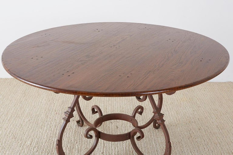 Italian Oak and Scrolled Iron Round Dining Table For Sale 5