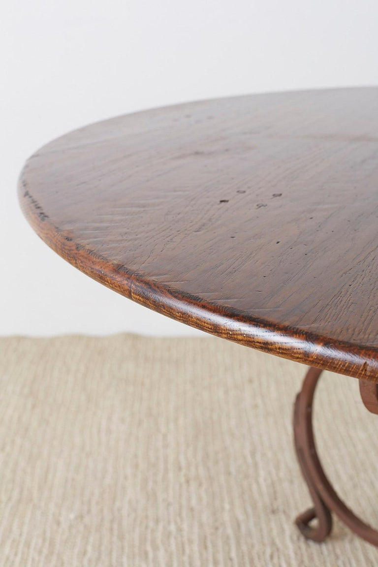 Italian Oak and Scrolled Iron Round Dining Table For Sale 7