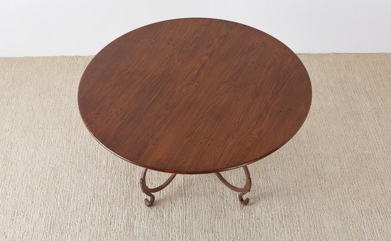 Rustic Italian Oak and Scrolled Iron Round Dining Table For Sale