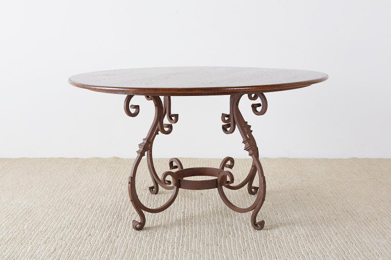 Hand-Crafted Italian Oak and Scrolled Iron Round Dining Table For Sale