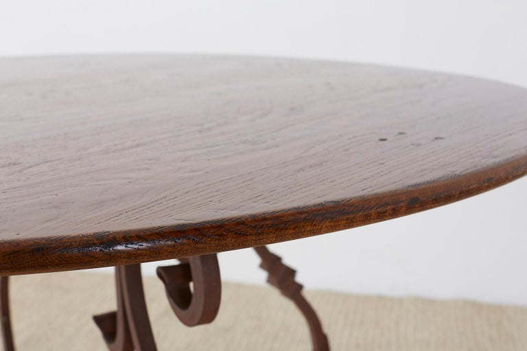 Italian Oak and Scrolled Iron Round Dining Table For Sale 3