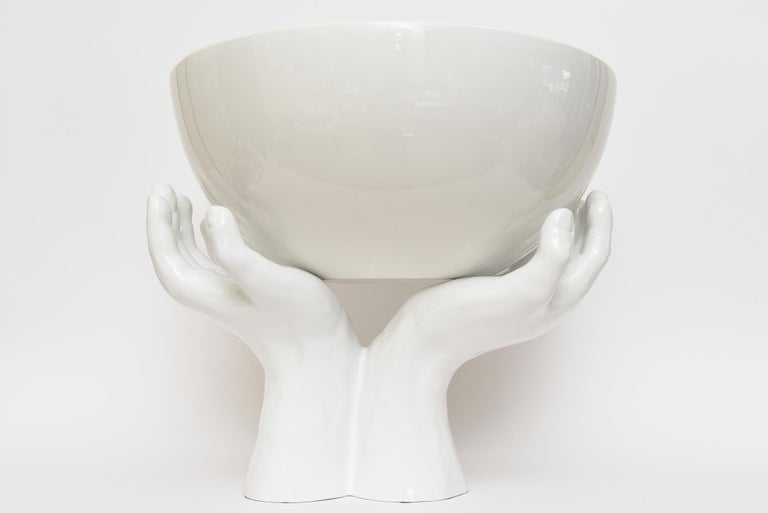 This amazing and very dramatic welcoming 2 part Italian ceramic sculpture is white to off white. The gigantic bowl sits on top of the welcome outstretched hands. We have never ever had this RARE version before and this is from the 70's. Both pieces