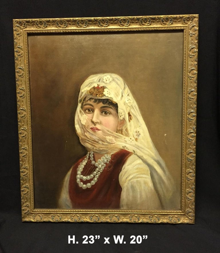 Italian orientalist oil on canvas painting. 20th century.   The fine oil painting depicting an orientalist woman dressed in traditional garments with a veil and pearls.  Meticulous attention was given to every detail of this orientalist
