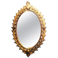 Italian Oval Giltwood Mirror with Gold Leaf, 20th Century