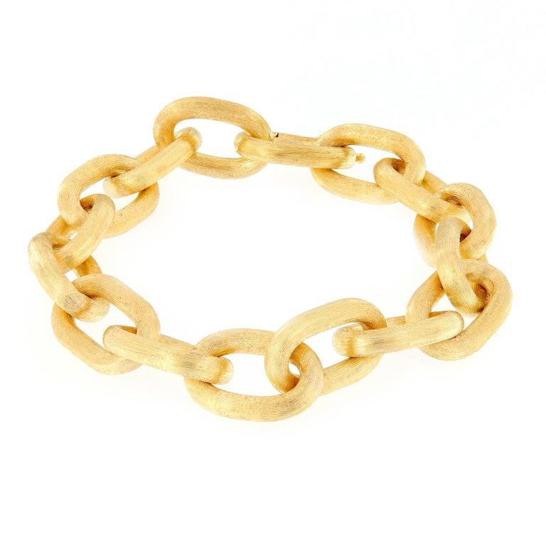 Italian Oval Link Textured Gold Bracelet For Sale