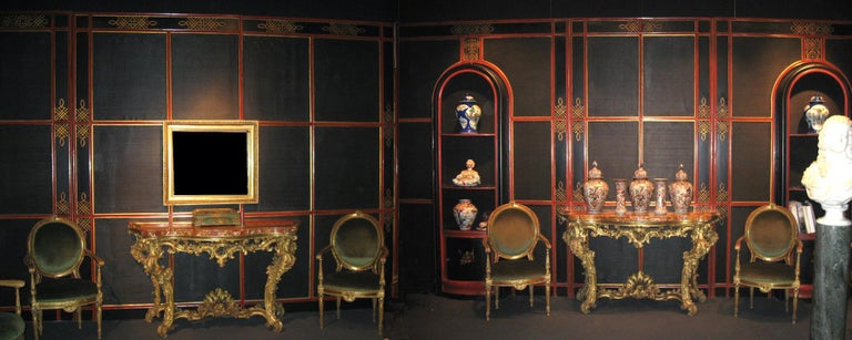 """A very fine early 20th century Italian """"japoneserie"""" painted and parcel-gilt Boiserie panels with a black painted canvas insert. Modular panels create a complete room with an amazing door and a pair of fine book cases or cabinets. Sophisticated"""