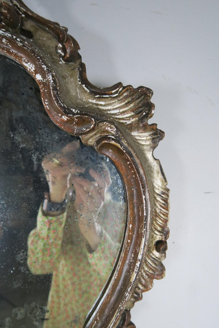 Italian Rococo style wood carved hour glass shaped mirror with antique painted finish.