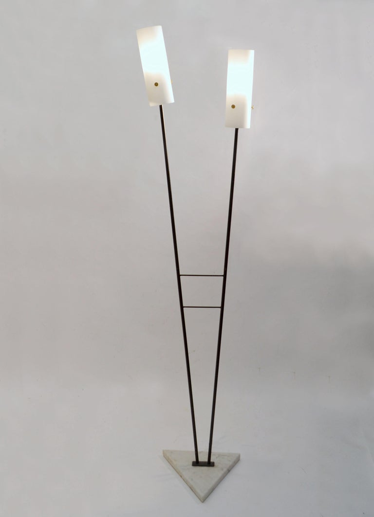 Pair of 1960's floor lamps with double V shape black metal stems lead a to cone shape opaline glass shades on triangle Carrara marble bases. The black lacquered frame create a strong shaped geometrical silhouette. It is rare to find these Italian