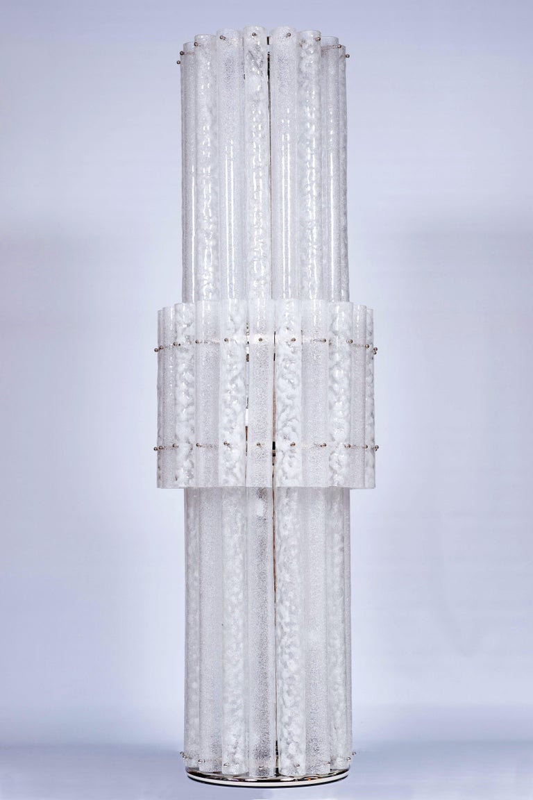 Elegant, massive, Italian Venetian pair of floor lamps in blown Murano glass with white waves, contemporary, 21st century. This is a pair of masterpieces, they are massive and extremely bright and elegant floor lamps; they are modern and composed