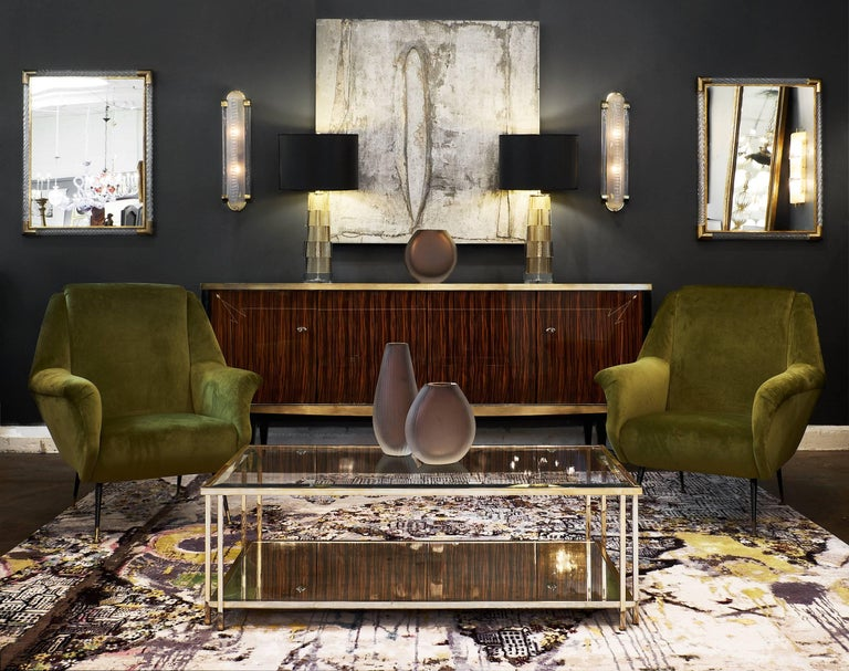 A stunning pair of Murano glass and brass mirrors by Ongaro e Fuga, featuring rectangular glass mirrors framed in brass, surrounded by crystal clear