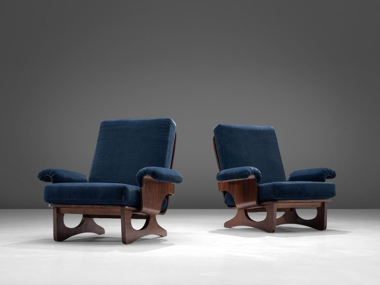 Pair of lounge chairs, blue velvet and rosewood, Italy, 1960s.