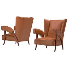 Italian Pair of Wingback Chairs with Characteristic Armrests