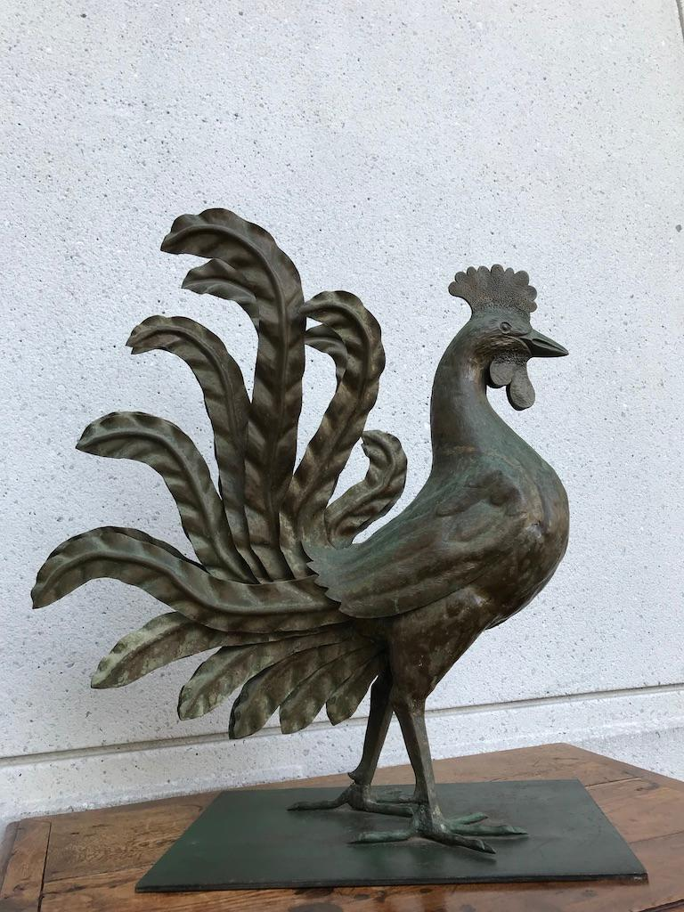 Very cool handwrought iron rooster with original green patina, the bird shown strutting and showing off his regalia of life-like feathers. Large scale at 28 by 26 by 12 inches. Very likely made in Tuscany, where the rooster, 'gallo', is the symbol